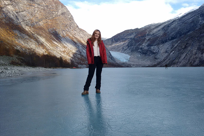 A student stood on a frozen lake in the bottom of a valley
