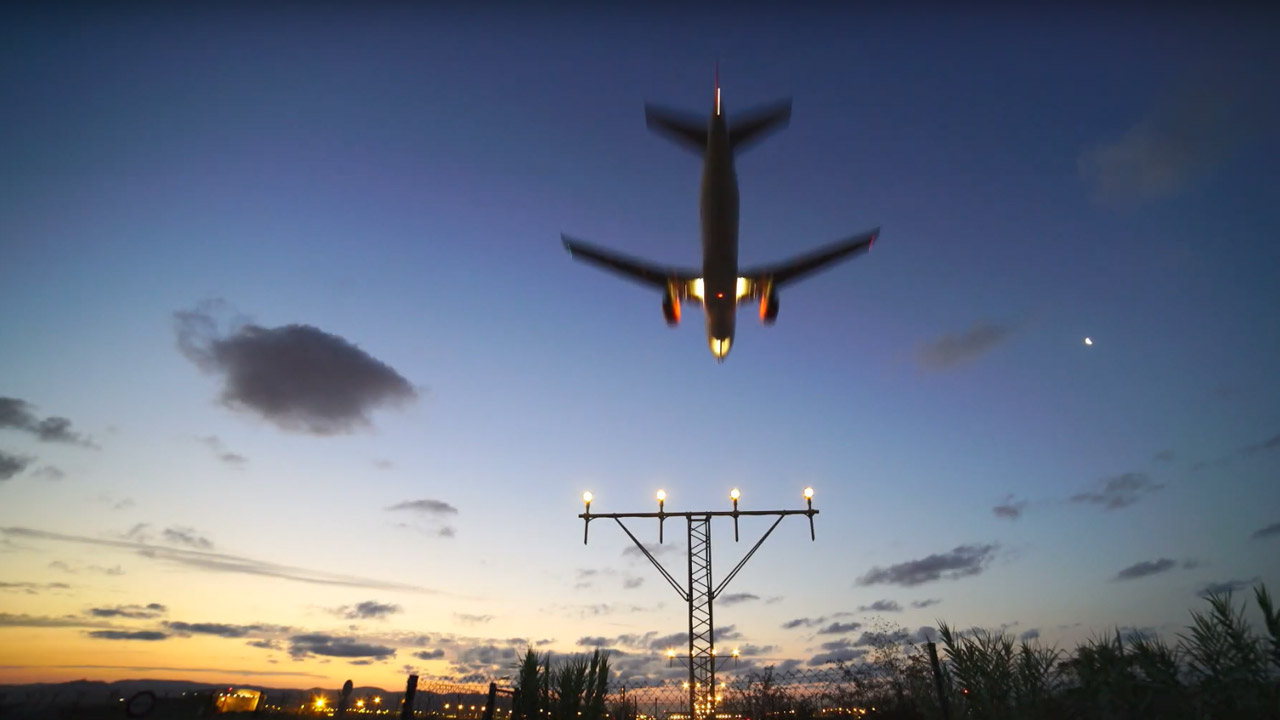 A video still of an aeroplane landing at night